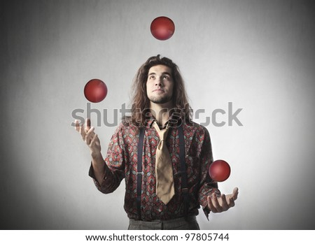 Young man juggling - stock photo