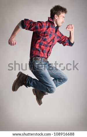 Young man jumping. - stock photo
