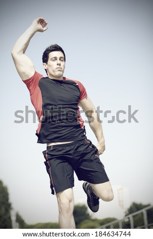 Young man jumping at the city park - stock photo