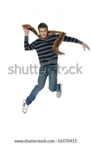 young man jumping for joy - stock photo