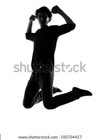 young man jumping happy silhouette in studio isolated on white background