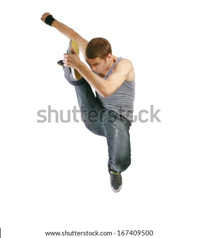 young man jumping high on isolated white - stock photo