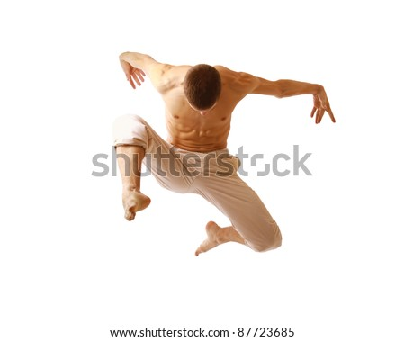 young man jumping high on isolated white background - stock photo