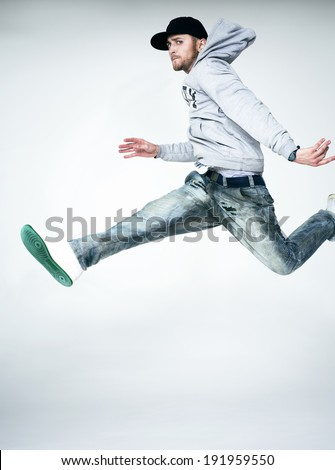 Young man jumping in air - stock photo