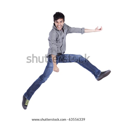Young man jumping isolated on white (some motion blur)