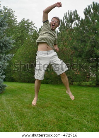 young man jumping with excitement