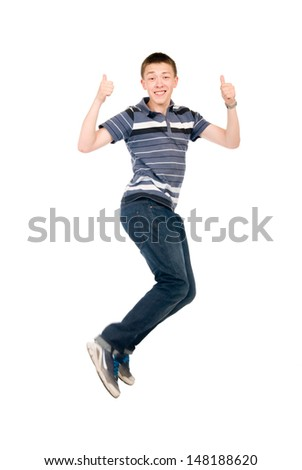 Young man jumping with raised thumbs up. Isolated on white background