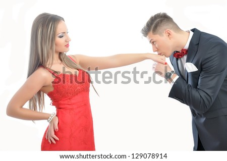 Young  man kissing his girlfriend hand - stock photo