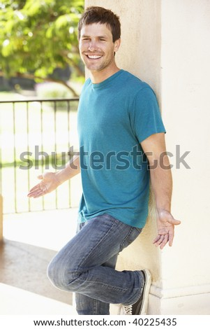Young Man Leaning Against Pillar