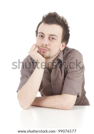 young man leaning on the table, looking at camera, white background