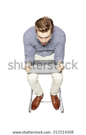 Young man leaning over the keyboard. - stock photo