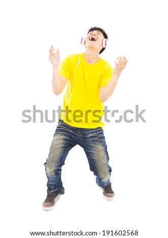 young man listening music and yelling out - stock photo