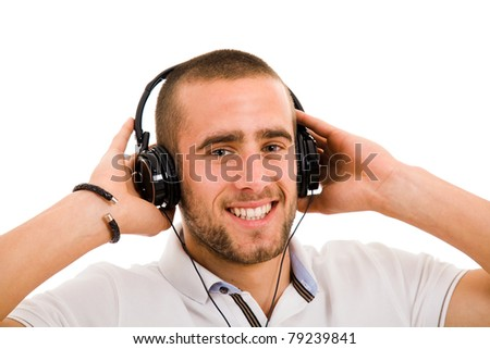 Young man listening music isolated on white