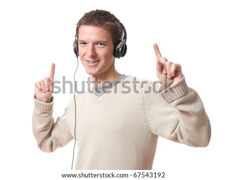 young man listening music with headphones isolated over white background - stock photo