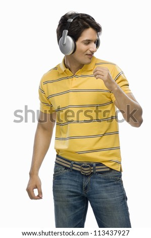 Young man listening musing and dancing