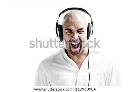 Young man listening to loud music and screaming isolated on white - stock photo
