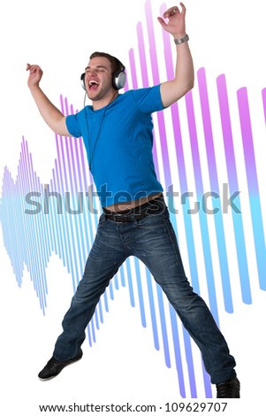 Young Man Listening to music and jumping in the air