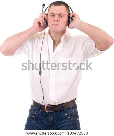 Young man listening to music on headphone over a white background