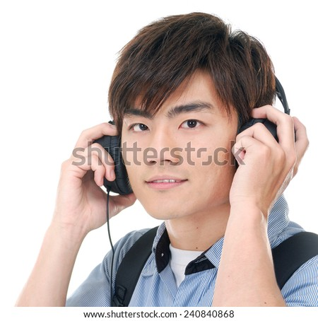 Young man listening to music with earphones - stock photo