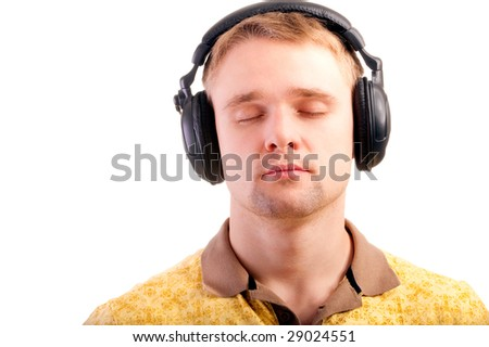Young man listens to beautiful music blindly.