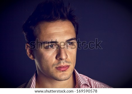 Young man looking - stock photo