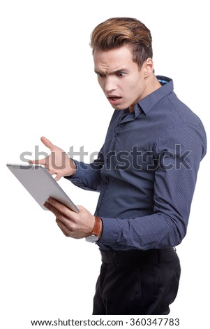 Young man Looking at a tablet, isolated in white