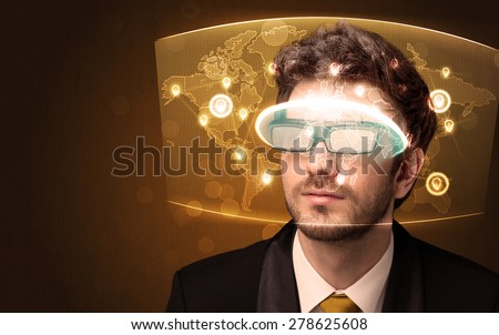 Young man looking at futuristic social network map concept - stock photo