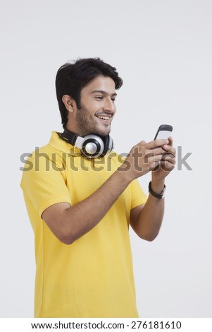 Young man looking at mobile phone - stock photo