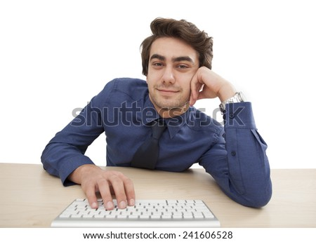Young man looking at screen - stock photo