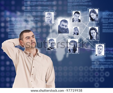 young man looking at social network structure in digital futuristic blue background - stock photo