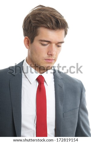 young man looking down - stock photo