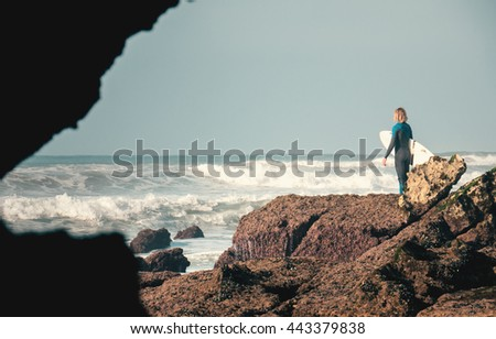 Young man looking for waves at Dracula's, Morocco