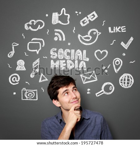 Young man looking up of Hand drawn illustration of social media sign and symbol doodles concept - stock photo