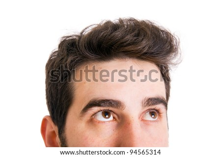 Young man looking up on white background