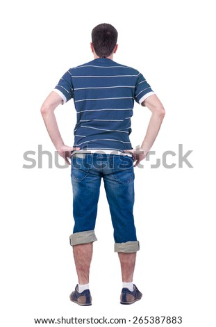 young man looks at  white background. rear view. Isolated over white .
