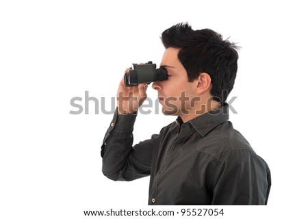 Young man looks through binoculars. Isolated on white background. - stock photo