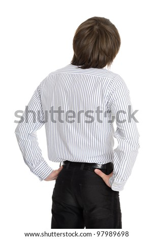 Young man looks up. Rear View. - stock photo