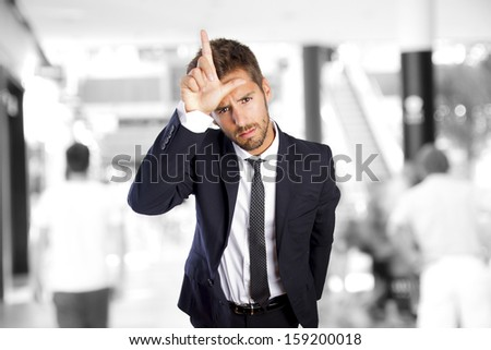 young man loser gesture in a shopping center