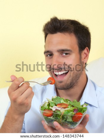 Young man loves vegetarian food - stock photo