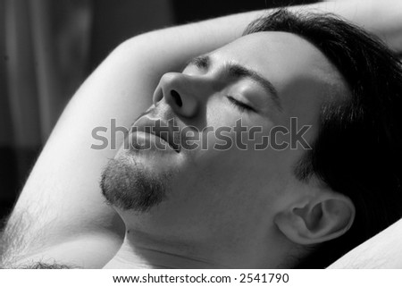 Young Man Lying in the sun, photo in black and white