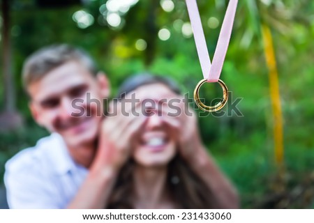 young man makes a proposal to his girlfriend - stock photo