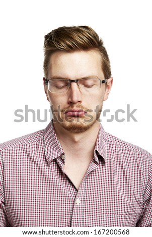 Young man makes a sad face. Isolated on white. - stock photo