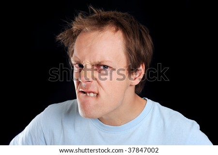 Young man makes facial expressions