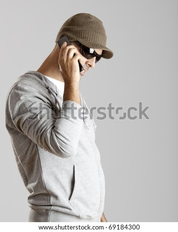 Young man making a phone call with a cellphone