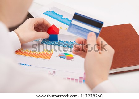 Young man making online payment via credit card - stock photo