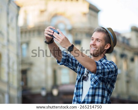 Young man making selfie - stock photo