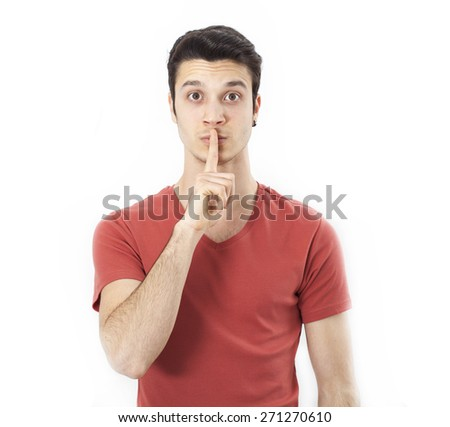 Young man making silence gesture - stock photo