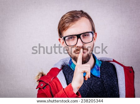 young man making silence gesture, shhhhh!! - stock photo