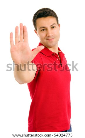 young man making stop with his hand on white background - stock photo