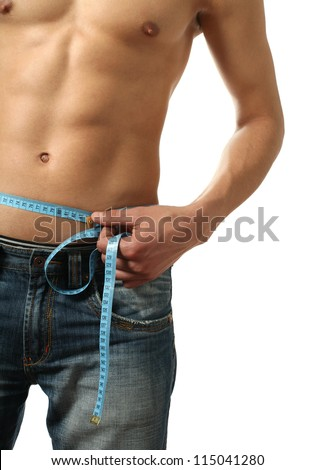 Young man measuring his waist by a meter isolated on white - stock photo
